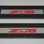 C7 14-UP Lamination Black Carbon Outer Door Sill with Light 2pcs/set (Core Exchange)  ($798.00 + Refundable Core Charge $250.00) (High Gloss or Matte Finish)